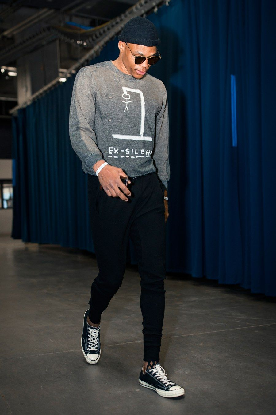 5e72bfbf9df7 Wearing a Scrapes and Gravel sweatshirt and Converse sneakers before a game  against the Orlando Magic.