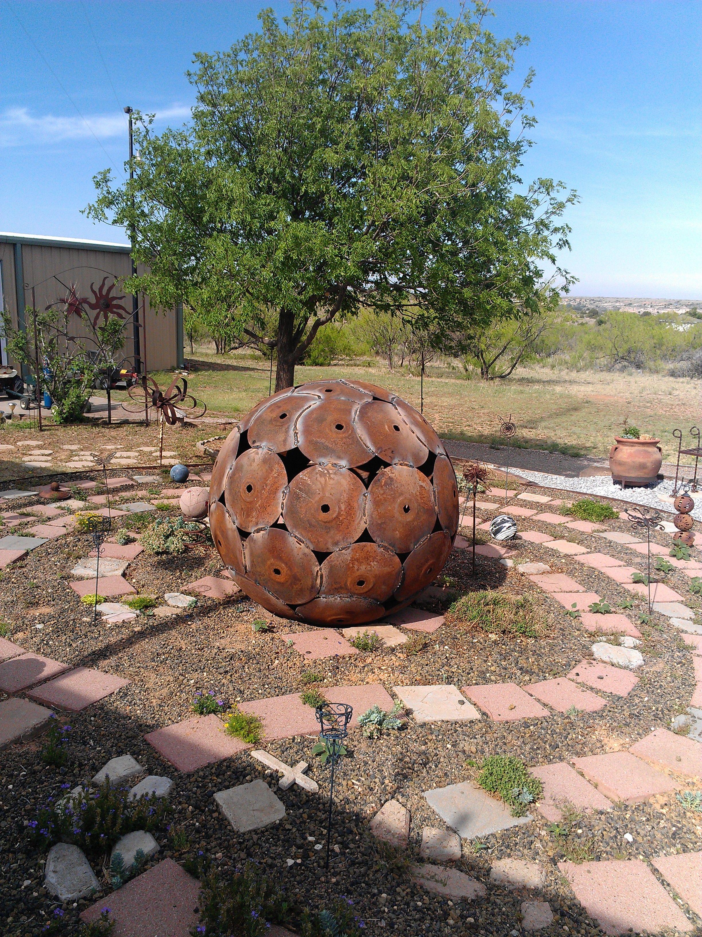 rusty art-farm equipment/garden ball from plow discs | made it ...