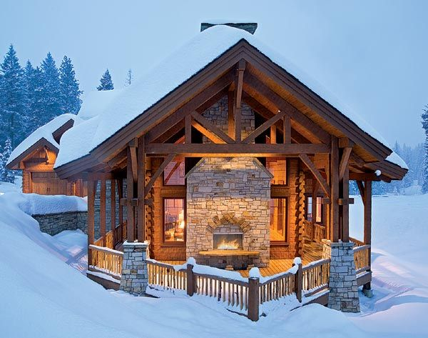 On A Snowy Winter S Night A Blazing Fire Warms The Cabin