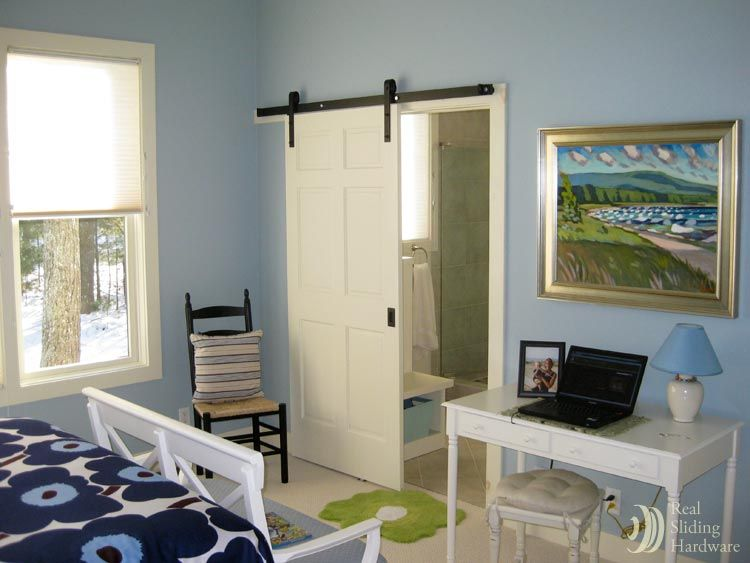 Put in a sliding door to save space in a small bathroom without the