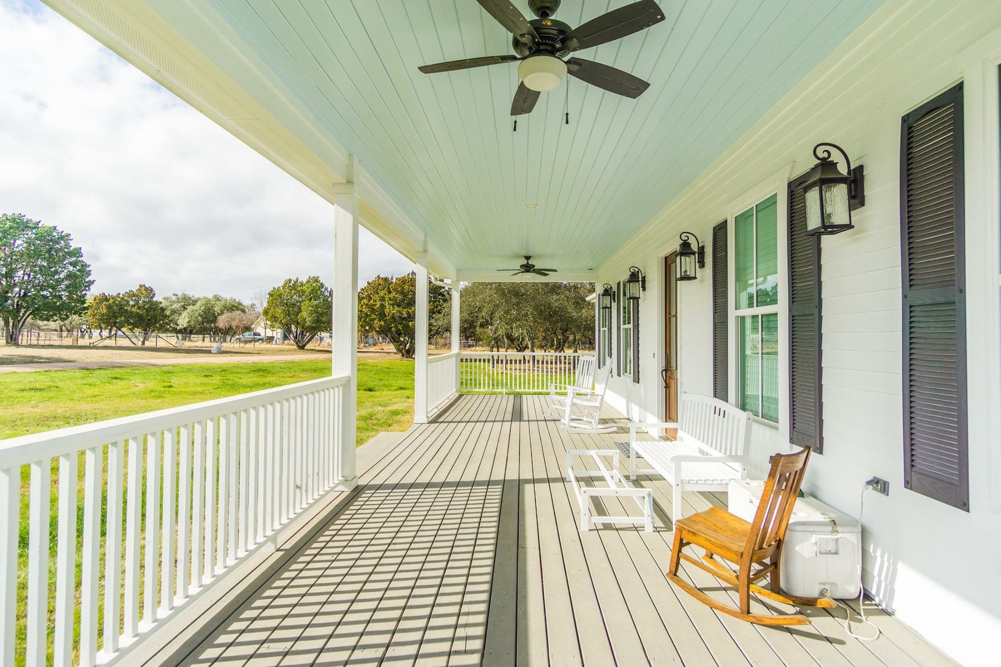Classic Old Looking Country Porch That Is New Construction Porch Lanterns Ceiling Fans Light Blue Ceiling To Pr Building Design Porch Lanterns Custom Homes