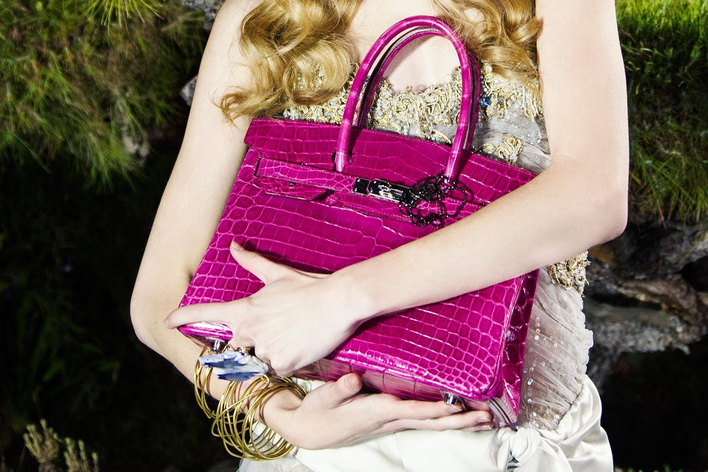 0709b3b38a The Black Rose Birkin is a one-of-a-kind Hermes pink crocodile  Birkin bag  customized with a diamond Black Rose pendant designed by celebrity jeweler   Jason ...