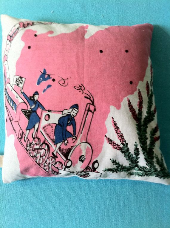 cute vintage pillow.  So cute, just find vintage tablecloths, dish towels, or fabric bolts would  make amazing pillows