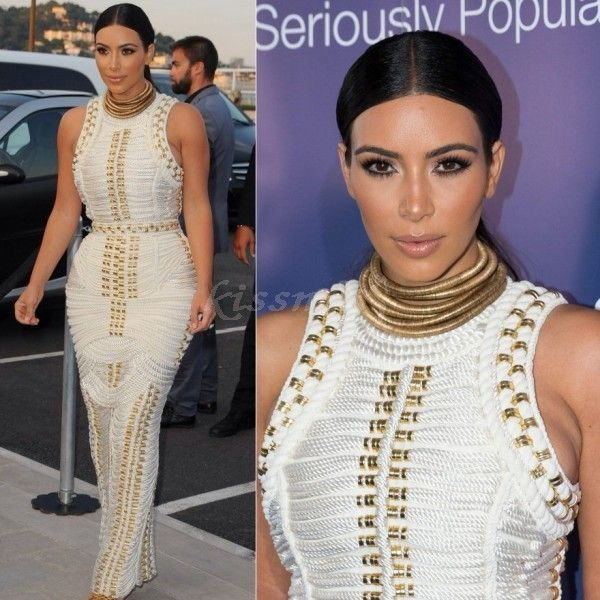 Kim K Studded white bandage gown, it's unflattering on her... agree?