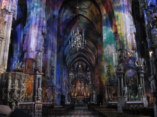Inside St. Stephen's Cathedral - Vienna, Austria. The beautiful color is from the sun's reflection through the stain glass windows.