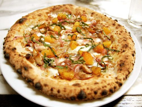 """Top This: Pollo (à la Trattoria Neapolis). The Pollo, topped with smoked chicken, Asiago cheese, fresh orange, pickled red onion, balsamic, and basil, will elicit the common cry of """"Chicken! No way,"""" but Executive Chef Bryant Wigger has solved the problem of dry rubbery chicken pizza: Smoking! #recipe"""