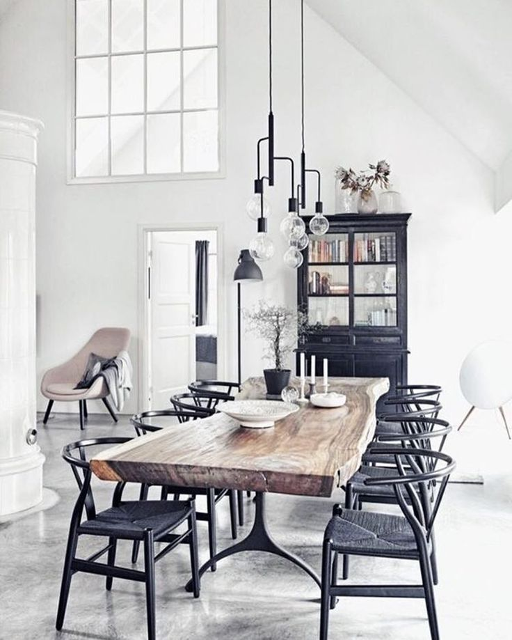 beautiful timber table paired with black wicker chairs