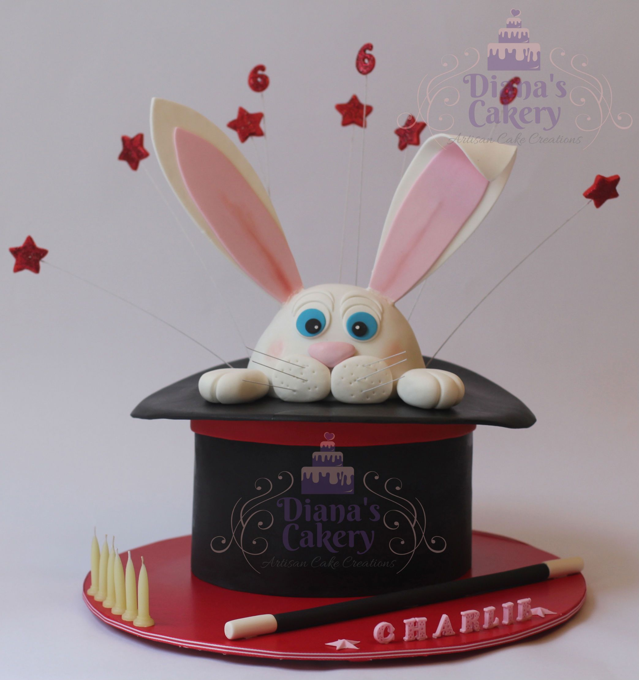 """Rabbit Out of Hat"" magic birthday cake Chocolate Sponge Cake Layered with milk chocolate ganache, covered with fondant. All edible apart from the candles and whiskers."