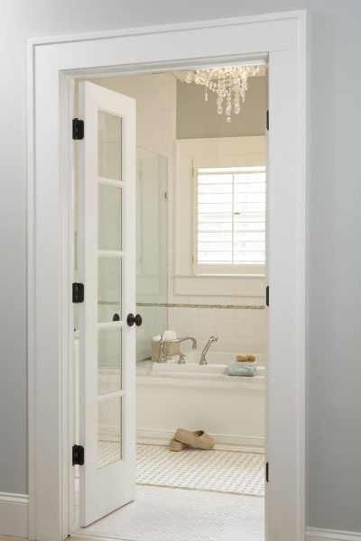 Gray and white bathroom with French doors     might be very handy to     Gray and white bathroom with French doors     might be very handy to have 2  smaller doors in kids bath between sink   tub wc area  no room for pocket  door
