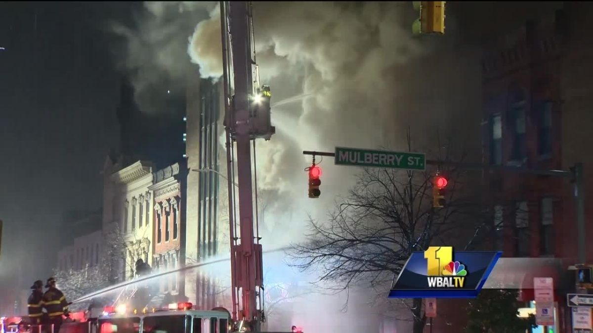 Baltimore firefighters are battling a fouralarm fire