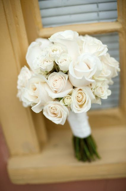 Black and white wedding bouquet using white roses and black and white striped ribbon description