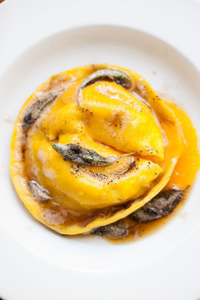 Homemade ravioli stuffed with seasoned ricotta and Parmesan cheese, and an egg yolk. Then topped with brown butter and sage. Easier than it looks, and just imagine the look on your guests faces at the first bite! (Raviolo żółtkiem i łzami płynące)