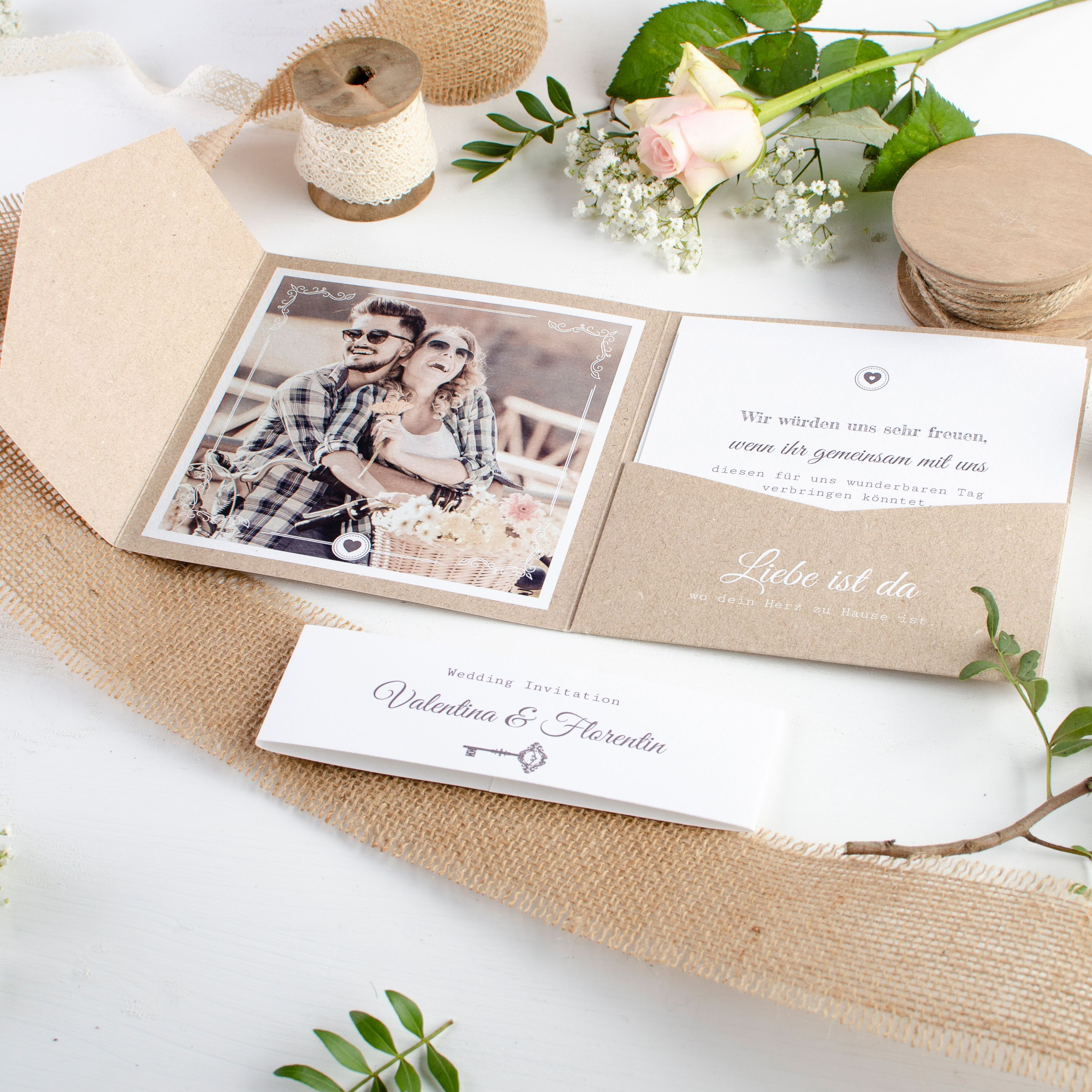 Photo of Invitation to the wedding as a pocket fold with a key motif