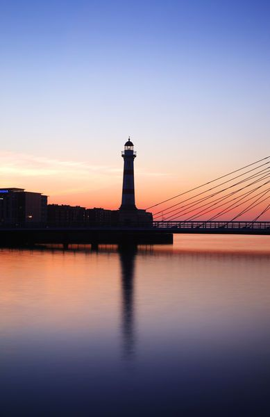 'Lighthouse and bridge at sunset.' by Lonely Planet Images on artflakes.com