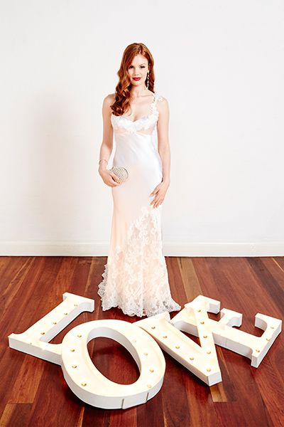 Classic lace. This elegant fabric complements many gown styles and can be demure or sexy depending on the shape, fit and neckline. Dress: Corston Couture 'Satin Slipper' gown.