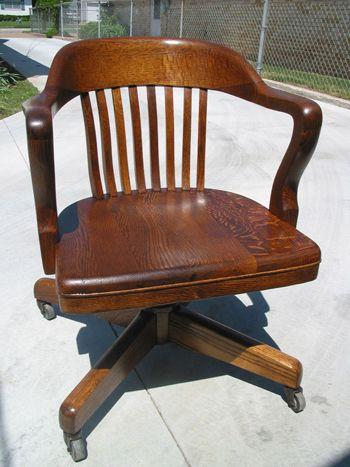 oak swivel chair ca eight slat back curved arms