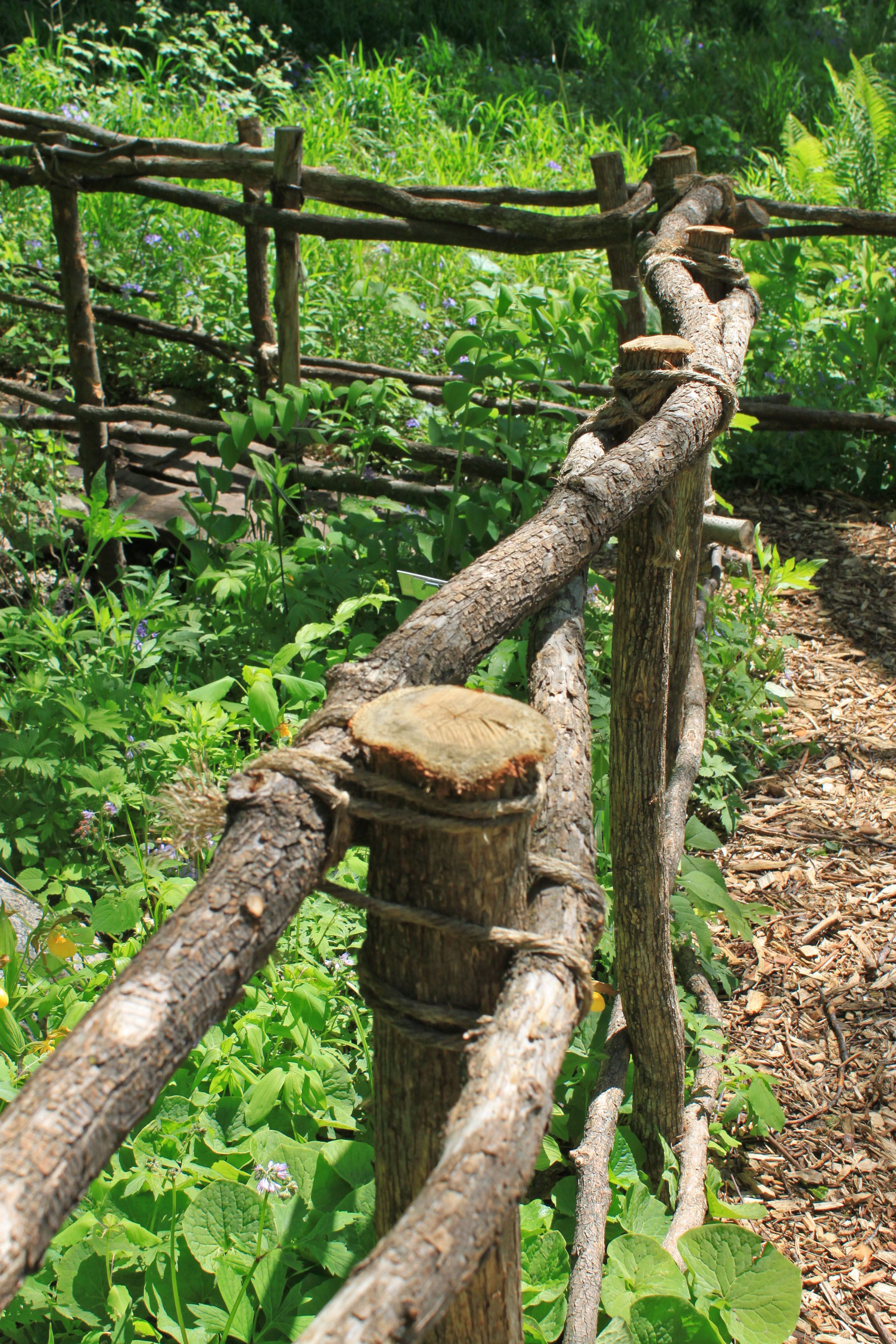 Old rustic fence our garden is surrounded by something similar one way of lashing together a rustic garden fence baanklon Image collections