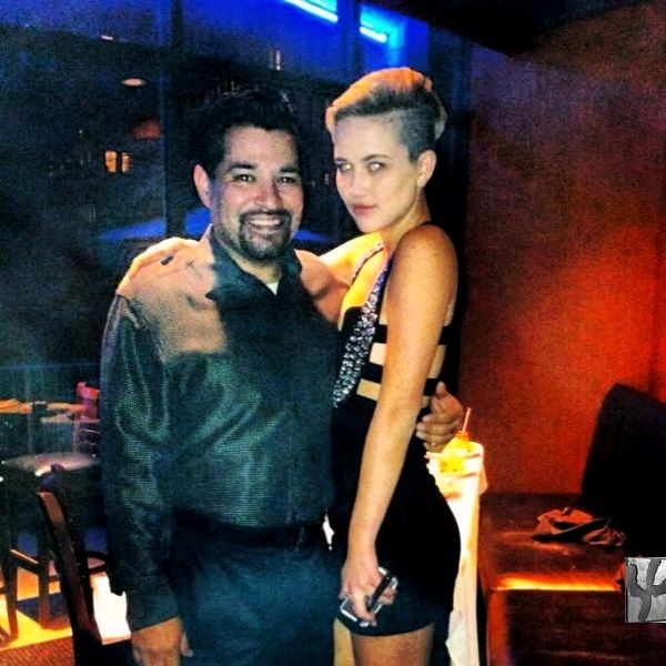 Miley Cyrus Poses With Roy Figueroa Manager At Iron Cactus In Dallas