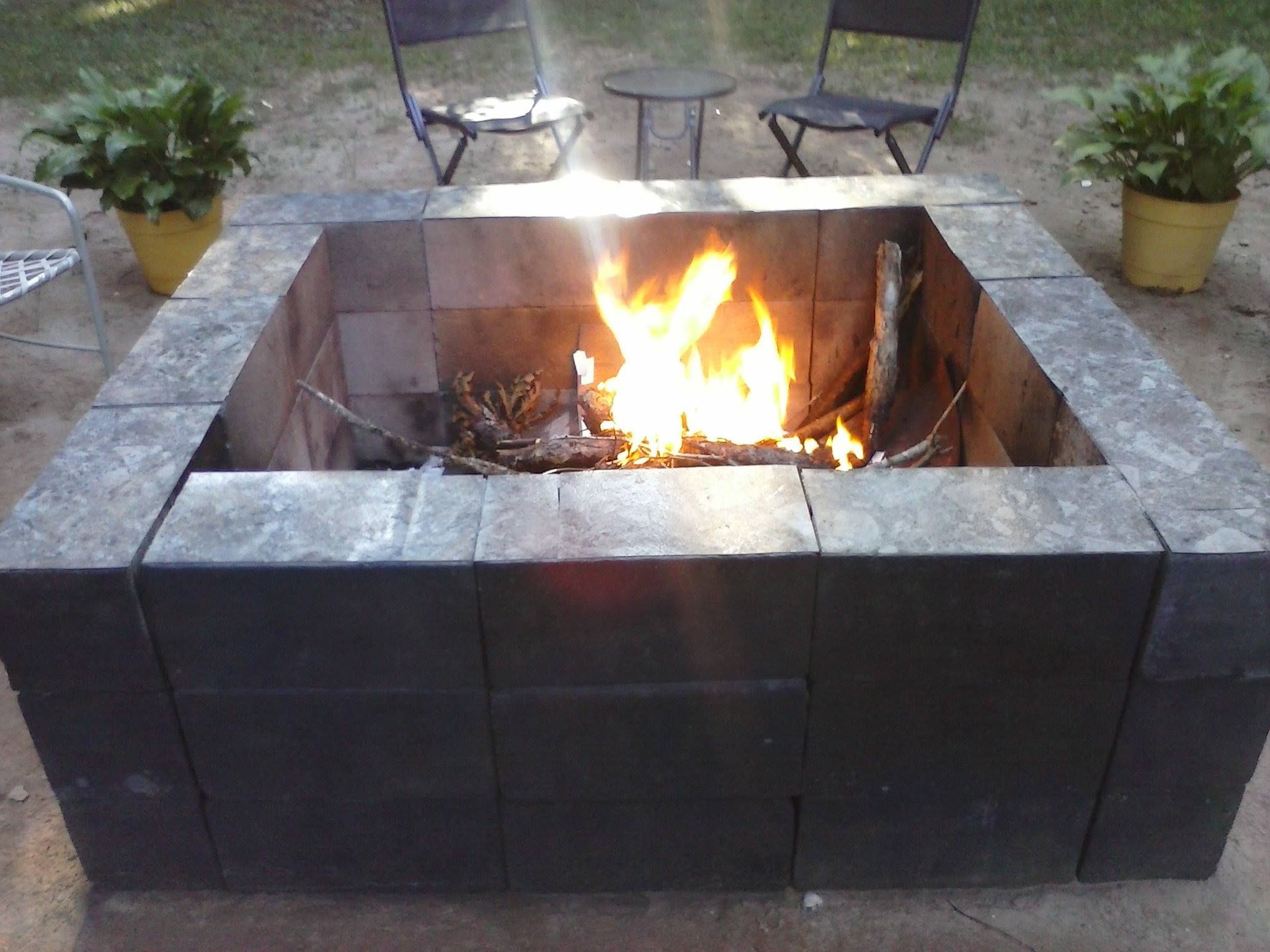 Cost Around 20 Made With Cinder Blocks Spray Paint And Laminate Fire Pit Outdoor Fire Pit Fire Pit Paint