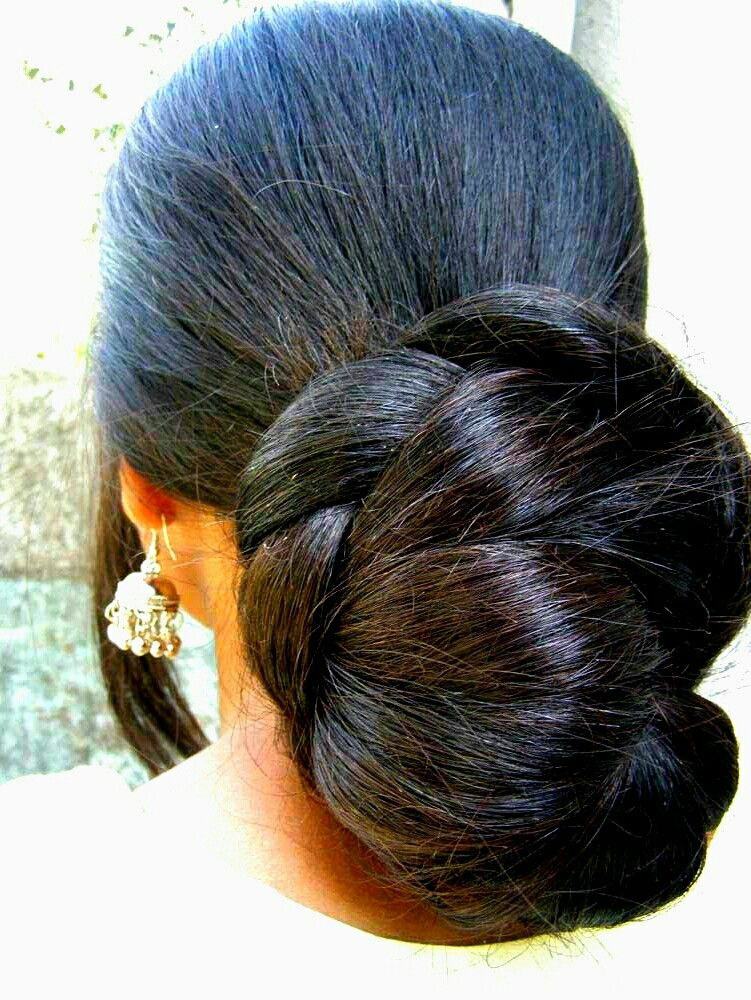 What A Beautiful Large Braided Low Bun Care However Should Be Taken Before Adopting Such Hairsty Bun Hairstyles For Long Hair Long Hair Styles Hot Beauty Hair