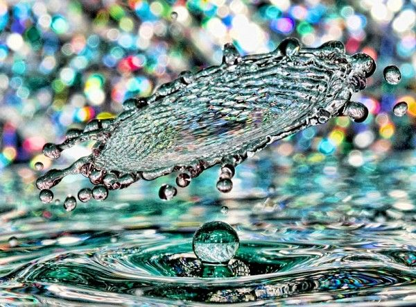 Have you tried high speed photography?  Take a look at this shot of a water droplet splashing.  Pretty amazing, you be the judge
