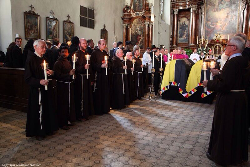 Funeral mass in the Chapel of the Church of the Capuchin Monks (under which is the Imperial Crypt), Vienna, Austria. The coffins are those of the former Crown Prince Otto--aka Otto von Habsburg--and of his wife, Regina, who died the year before him and was re-buried in the Imperial Crypt, July 2011. (Private Archive; Photo by Jeannette Handler)