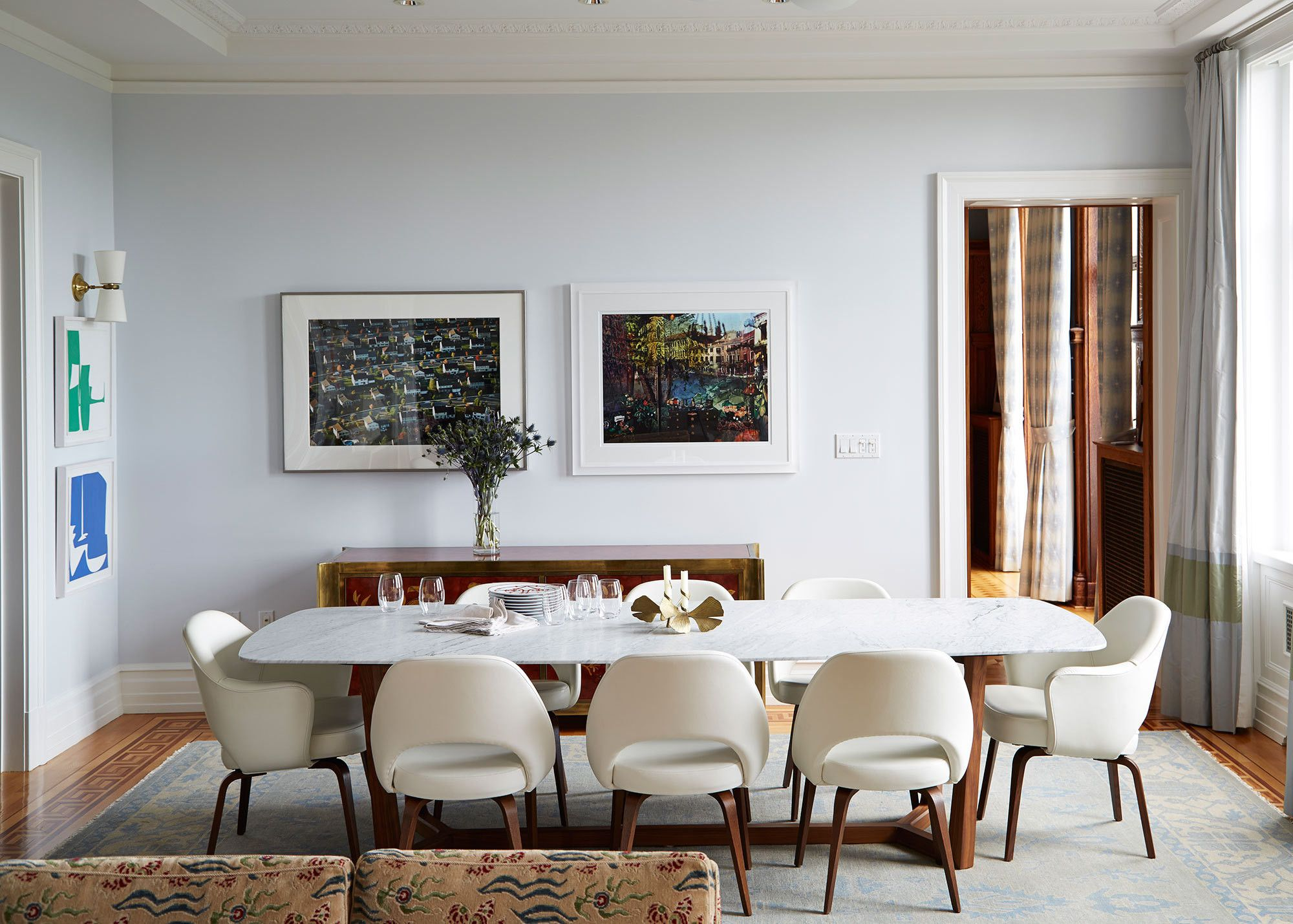 The Dining Room Adjoins Open Living Area And Is Grounded By Cool Toned