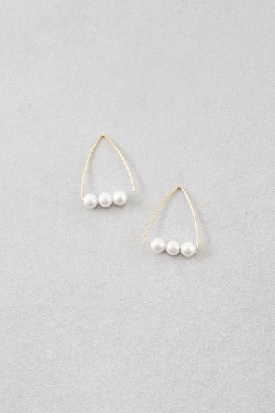 Gold triangle threader earrings with pearls.