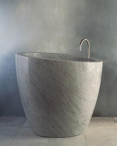 "Stone Forest's Eau soaking tub is fashioned from a single slab of Car­rara marble. It measures 42"" h. x 38"" w. x 48"" dia. and holds a generous 75 gallons. Priced at $25,500 without fittings, the tub can be custom sized and carved in a variety of stones, including limestone and granite. 888-682-2987; stoneforest.com"