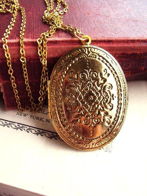This long necklace has a beautiful vintage large locket. The locket is an antique gold tone metal with matching chain. The locket has and ornate pressed design on both sides. It is 2 1/2 in. long, and 1 3/4 in. wide. The chain is 30 in. long. It is in great vintage condition. Thank you for looking