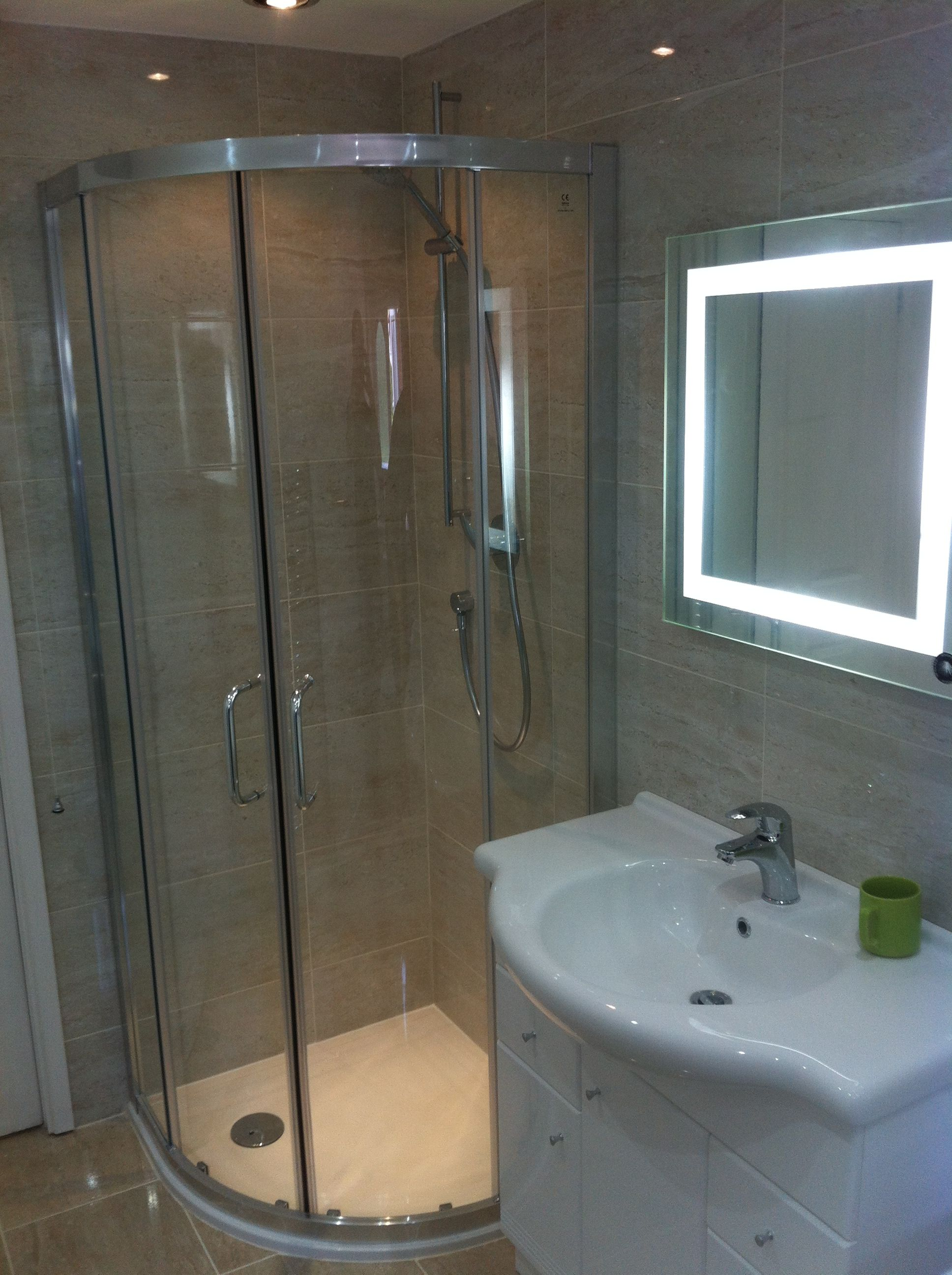 Shower cubicle with large sink and illuminated mirror   Bathrooms ...