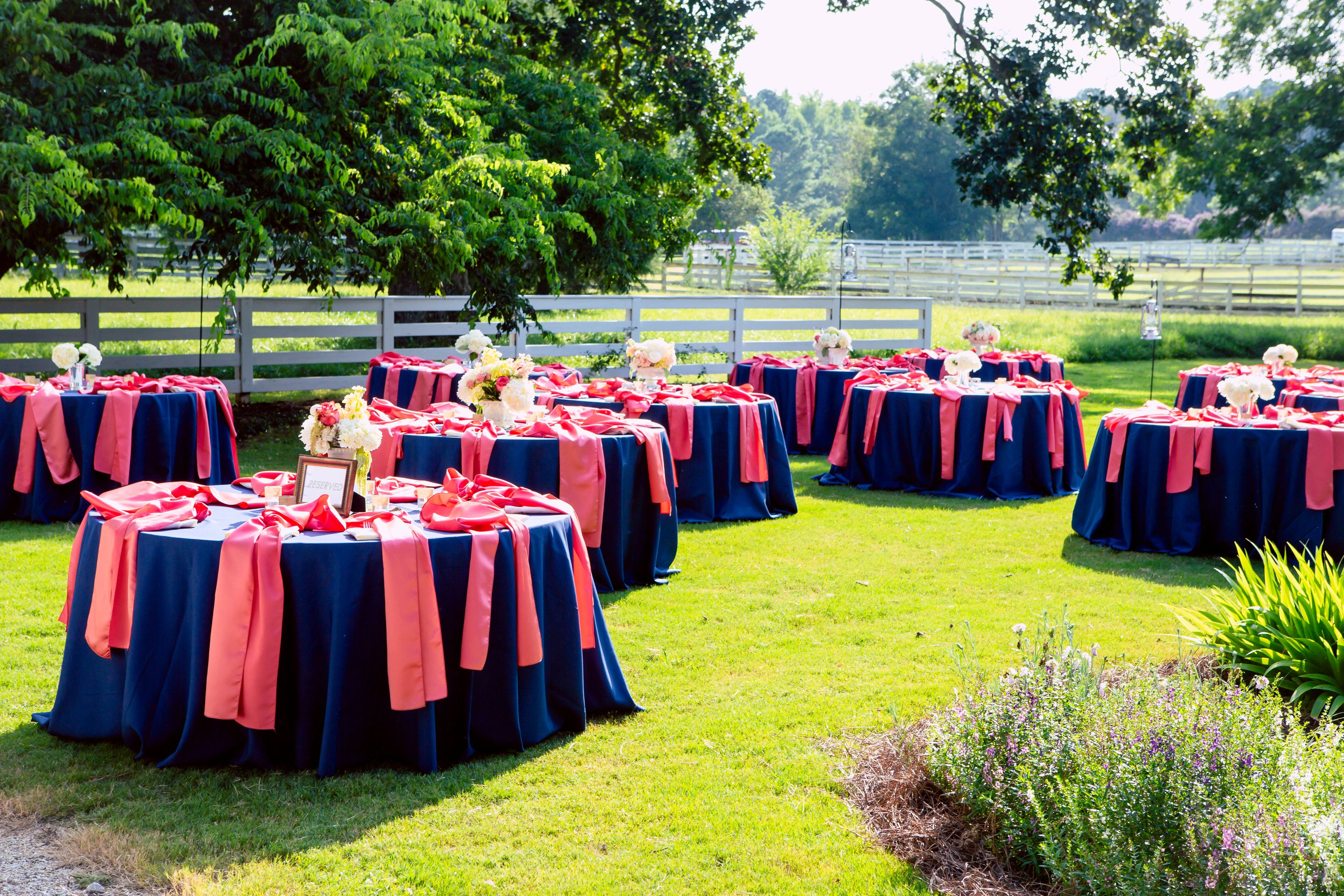 Aren't these #outdoortables so #lovely, #bright + #cheerful?!  ::Jordan + Michael's cheerful outdoor wedding at Cloverleaf Farms in Arnoldsville, Georgia:: #outdoorwedding #pink #blue #summerwedding #grass #cloverleaffarm #weddingphotography