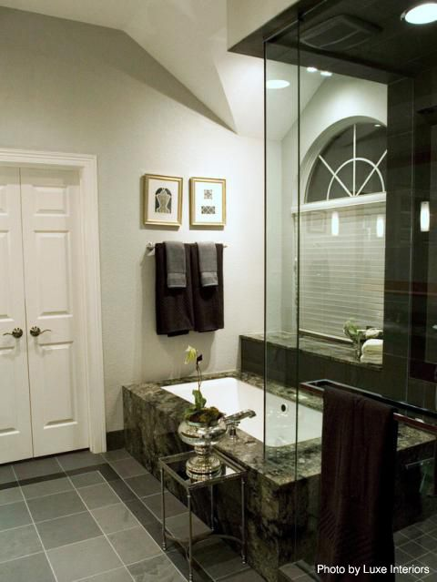 Remodeled bathroom with drop in tub, gray porcelain tile flooring ...
