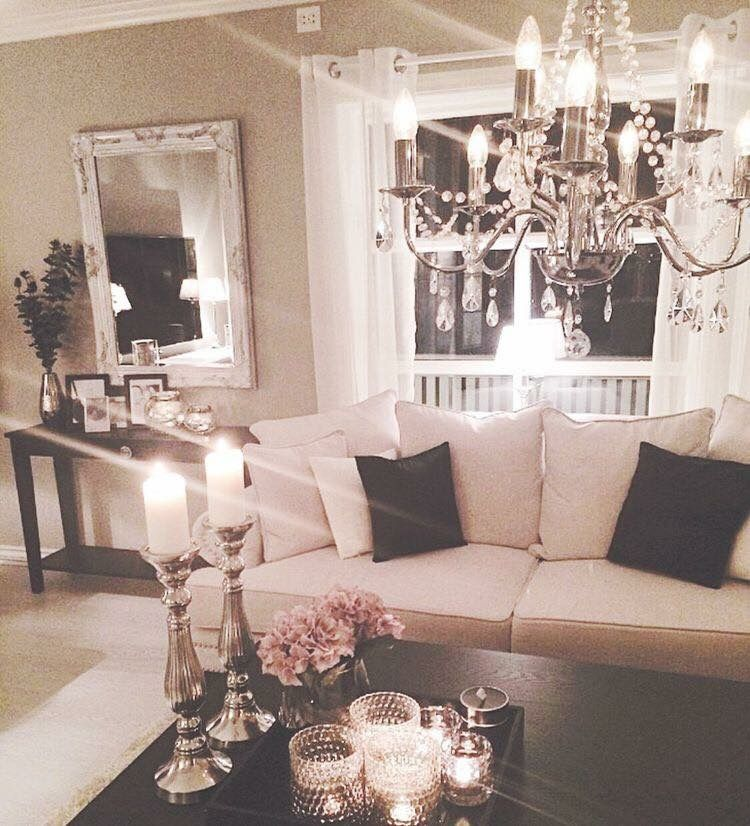 Chandeliers can be a fun decorative touch in living rooms since they provide a nice glow