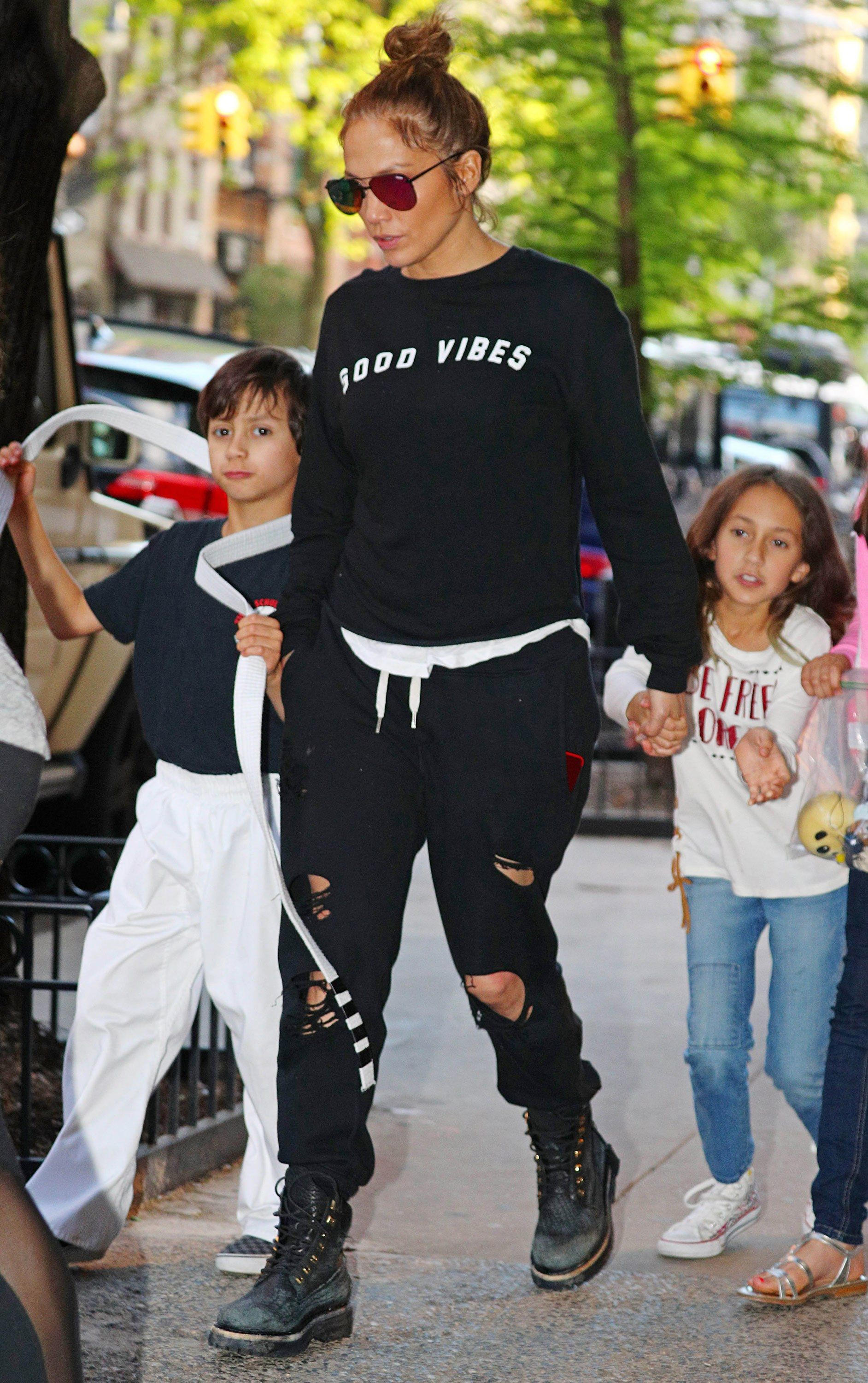 225200e96 Jennifer Lopez Elevates Mom-Off-Duty Style in Tone-on-Tone Sweats and Timbs