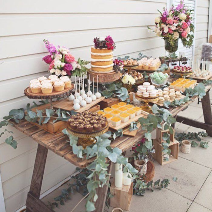 A rustic dessert table for a secret garden themed bridal for Table 52 dessert