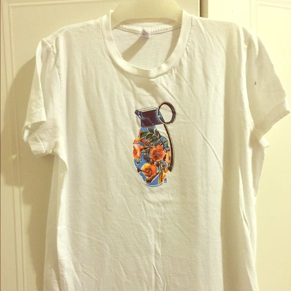 American Apparel floral grenade tee Gently loved American apparel tee with floral grenade. Says size xl but will deff fit small/medium. There is a marker for stain on sleeve. I was planning on cutting sleeves off and making a muscle tank! American Apparel Tops Tees - Short Sleeve