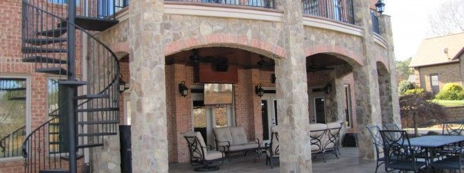 2nd story covered decks stone brick patio arches for Two story spiral staircase