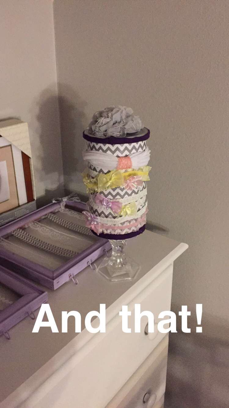 Headband holder!  Scrapbook paper $1 Candle holder from dollar tree Oatmeal container (cleaned out) Modpodge  Hot glue gun Purple scrap fabric