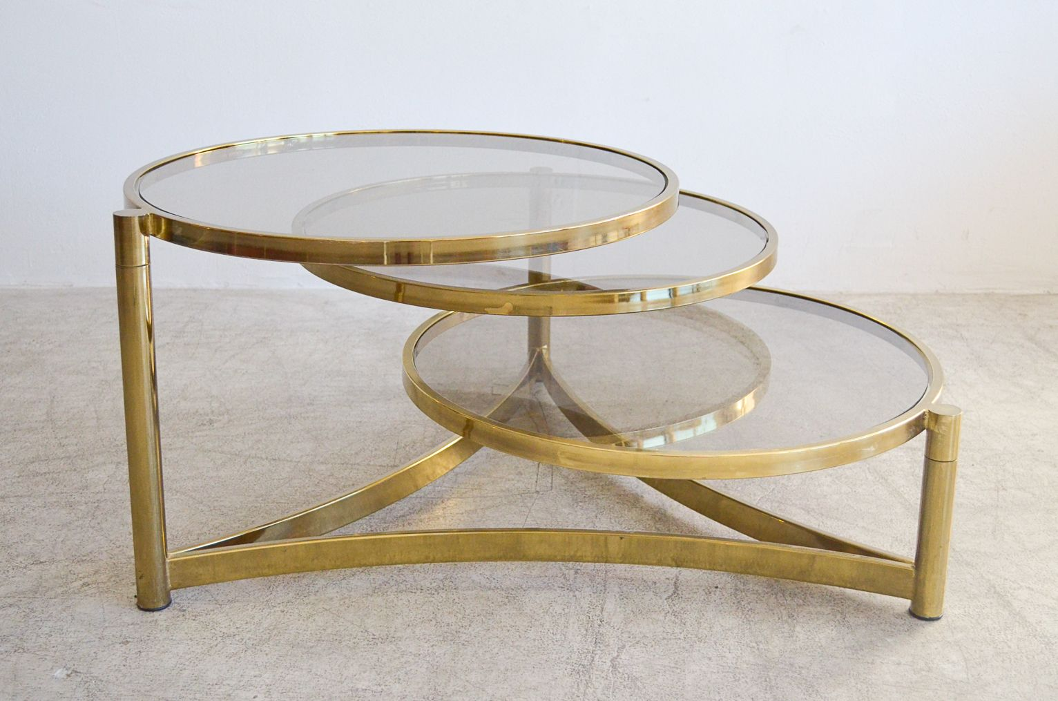Sold Milo Baughman Tri Level Brass And Glass Swivel Coffee Table The Modern Vault Milo Baughman Coffee Table Circular Coffee Table [ 1015 x 1532 Pixel ]