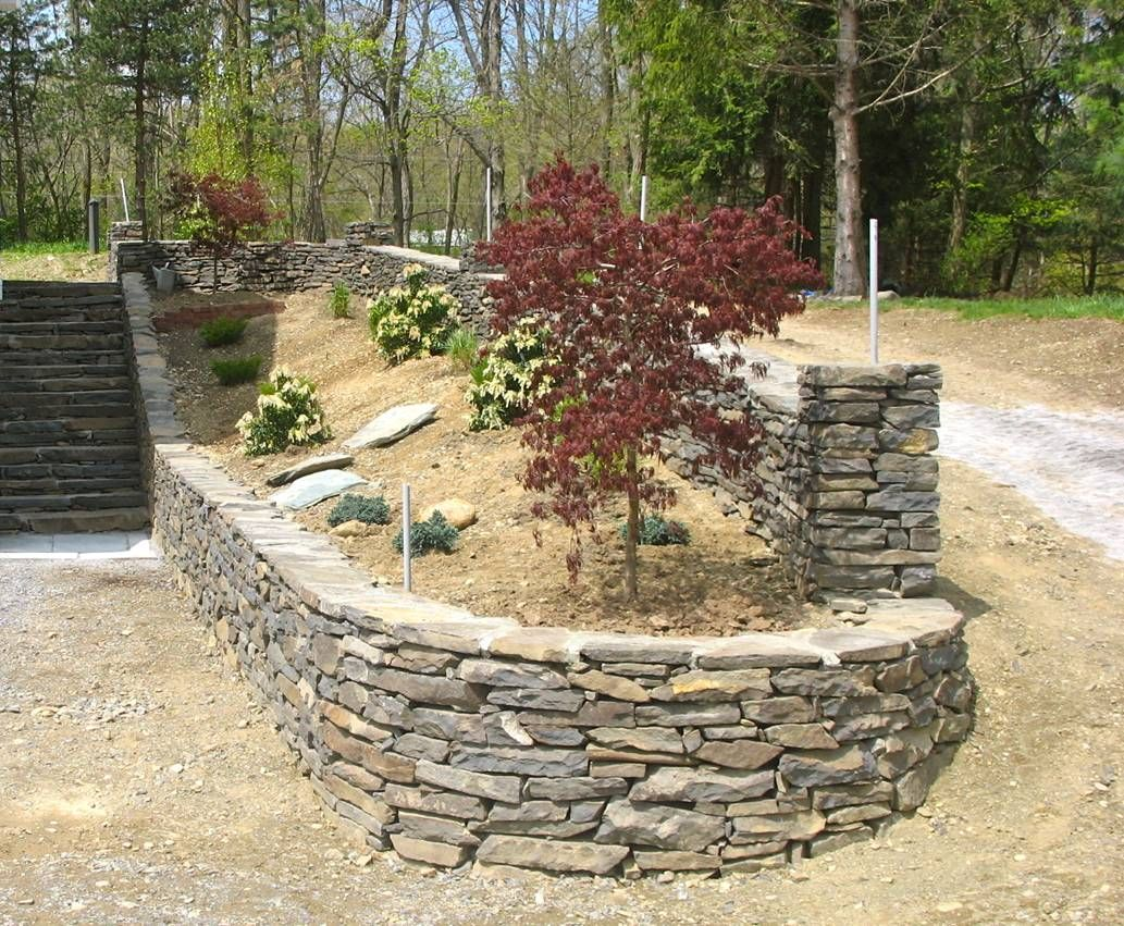 Stone retaining walls stone and retaining walls hudson for Stone retaining wall ideas