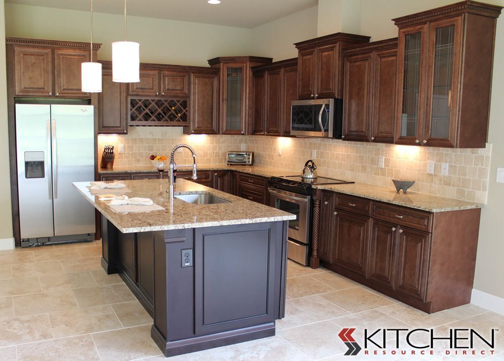 Warm Wood Stained Wall Cabinets With A Tumbled Stone Back Splash Espresso Stained Island And Stainless Steel Kitchen Layout Discount Kitchen Cabinets Kitchen