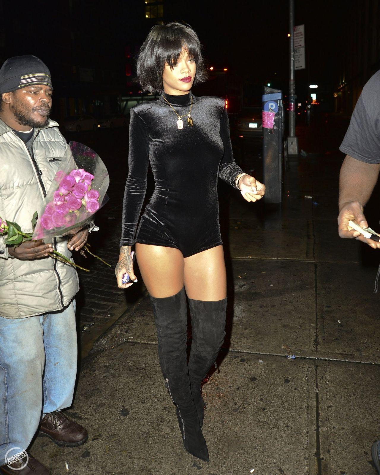 57ec6935ea2 Rihanna - Black Velvet Jumpsuit   Ober-The-Knee Boots