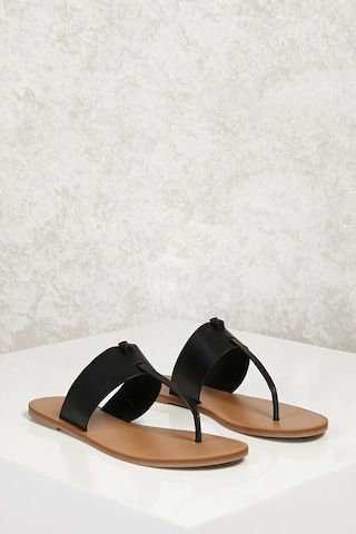 a1442f97de1 A pair of lightweight sandals featuring a wide faux leather top strap with  a knotted thong construction.