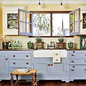 I've always been a fan of all white cabinets, but the blue!! So pretty!