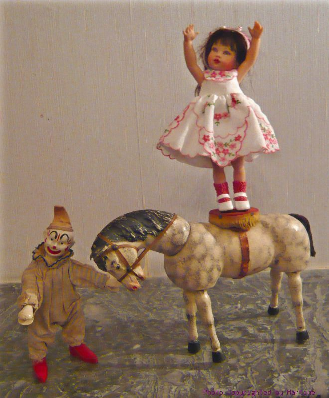 Cora Belle Kish Riley repaint doll with old antique Schoenhut dapple gray wood wooden horse with Schoenhut Humpty Dumpty Circus clown toy doll at Dolly Street Circus France photo by Martine 2008