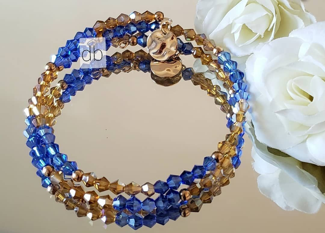 A very attractive Blue and Brown Crystal Wrap Bracelet *New Collection* *DM for ... #accessoryaddict #art #craftymama #craftymom #craftymoms #craftywife #DIY