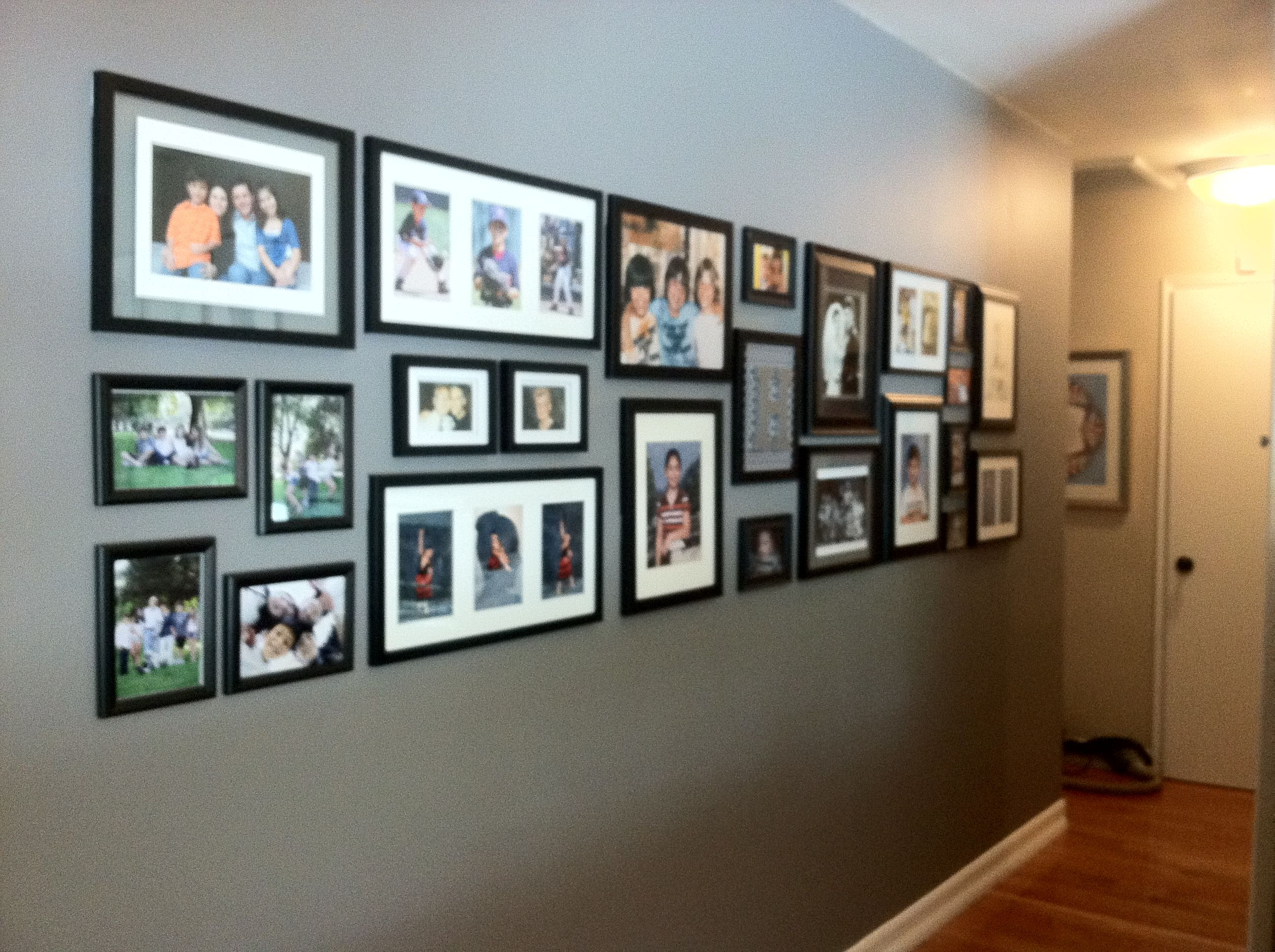 Family photo wall. Paint: Behr Pewter Ring | Photo wall | Pinterest ...