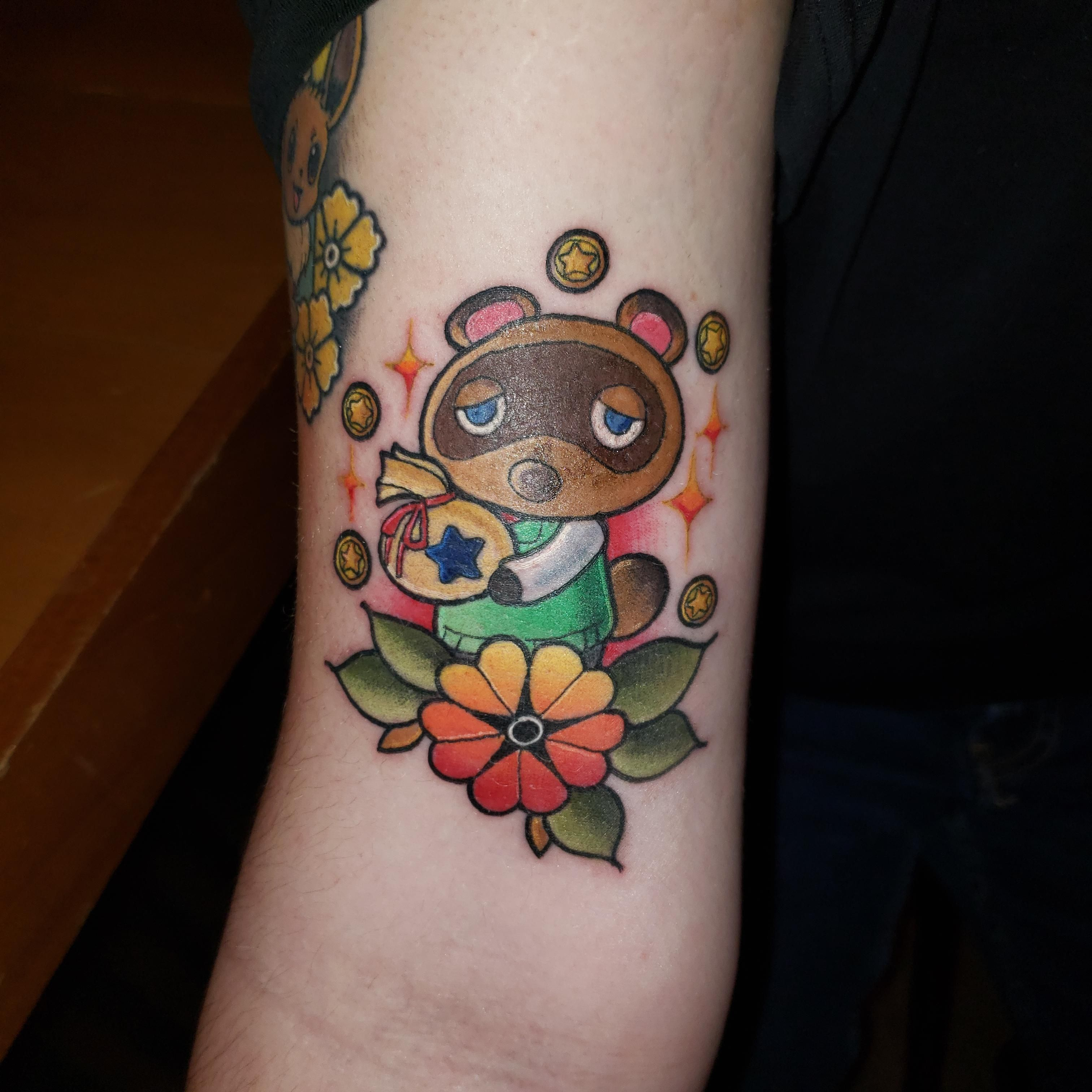 Another Nerdy Tattoo On My Arm Tom Nook From Animal Crossing This Time Once Again Done By Cody Body Gallery Tattoo And Nerdy Tattoos Tattoos Strawberry Tattoo
