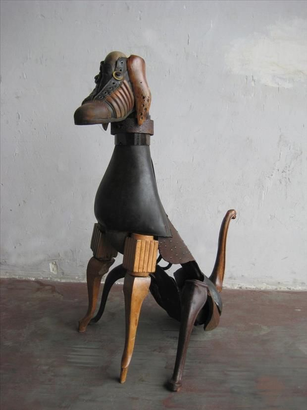 Horse or dog ? art from repurposed old wooden furniture legs and salvaged pieces.  Do not know who made this original  lovely piece but we love the idea; Upcycle, Recycle, Salvage, diy, thrift, flea, repurpose, refashion!  For vintage ideas and goods shop at Estate ReSale  ReDesign, Bonita Springs, FL